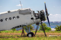 The faulty plane on repair restoration. The old plane, the faulty plane on repair restoration AN-2 agricultural aeroplane costs in the field in a green grass Stock Images