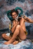 Faun playing the flute Stock Photography