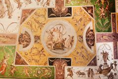 Fauns and angels dance on the ceiling with fresco, inside 14th century Palazzo Vecchio, Florence. Medieval art of Italy. Fauns and angels dance on the ceiling stock photo