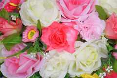 Fausse fleur et fond floral Photographie stock