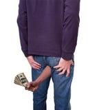 Fausse monnaie sortant de votre bout, âne Image libre de droits