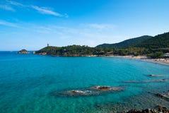 Fautea beach with Genoese tower. Corsica, N198 between Porto Veccio and Bastia Stock Image