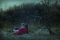 Fauteuil abandonné effrayant Images libres de droits