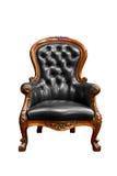 Fauteuil en cuir noir de luxe d'isolement Image stock