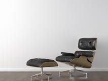 Fauteuil en cuir noir sur le blanc Photo stock