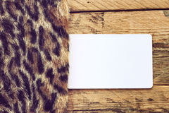 Faux fur leopard and empty paper tag Stock Photography