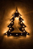 Faux illuminated Christmas Tree with stars Stock Image