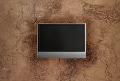 Faux painted stucco wall with LCD tv. Faux painted and textured stucco wall with LCD tv Royalty Free Stock Images