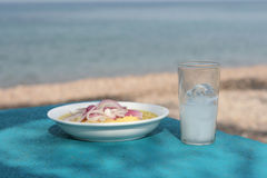 Fava with ouzo. Greek traditional food fava with glass of ouzo by the sea Royalty Free Stock Photography