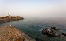 Favaritx latarnia morska przy zmierzchem - Minorca Baleari zdjęcia stock