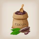Fave di cacao in una borsa Fotografia Stock Libera da Diritti