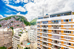 Favela, Brazilian slum on a hill behind a residential area in Ri Royalty Free Stock Photos