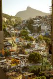 Favela in Rio de Janeiro, Brazil. Favela in Rio de Janeiro with Christ the Redeemer statue in the background Royalty Free Stock Photo