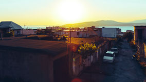 Favelas, slum, garages in the background of a picturesque landscape and sunset. Gelendzhik, North Caucasus, Russia Royalty Free Stock Photo