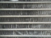 Favo de mel do radiador do carro textured para o fundo A profundidade de campo suporta sobre de um detalhe do tapete persa Fotos de Stock