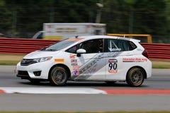 Favorable coche de carreras apto de Honda en el curso Fotos de archivo