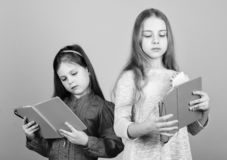 Favorite fairytale. Sisters pick books to read together. Adorable girls love books. Secret diary. Opening doors through. Literacy. Kids girls with books or royalty free stock image