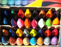 Colourful Crayons neatly stacked in a box Royalty Free Stock Image