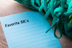Favorite 5K`s run walk concept on notebook and wooden board. 5K run walk concept on notebook and wooden board Royalty Free Stock Image