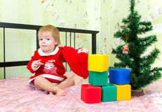 Favorite New Year presents and toys of little toddler. Near Christmas tree Stock Photos