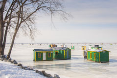 The favorite sport for non-athletes. These small fishing huts are on Lake Champlain in Quebec Royalty Free Stock Photo