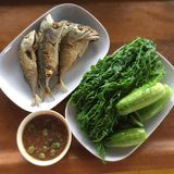 Favorite Thai food set. Is include with deep fried Mackerel fish and boiled local vegetable and Thai chili paste Royalty Free Stock Photo