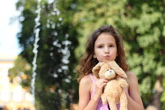 Favorite toy. Portrait of a girl with a favorite toy on the background of nature. soft focus. bokeh Stock Photos