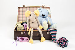 Favorite toys. In an old suitcase Royalty Free Stock Photo