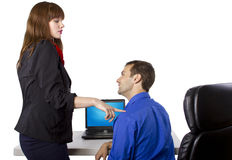 Favors at Work. Female coworker is flirting to get favors at work Stock Image
