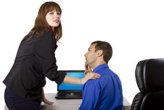 Favors at Work. Female coworker is flirting to get favors at work Stock Photo