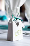Favour Bag at a Wedding. A small favour bag with a green ribbon at a wedding Royalty Free Stock Images
