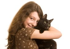 Favourite cat. Girl with a black cat on a white background Stock Photos
