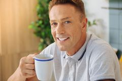Joyful happy man having tea Royalty Free Stock Photos
