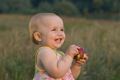 Favourite fruit. An apple. It is necessary for small children to eat fresh fruit and vegetables! Vitamins stimulate correct development and growth of the child Stock Photos