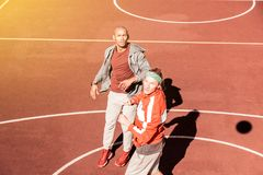 Nice sportive young men playing together basketball. Favourite game. Nice sportive men playing together basketball while having a competition royalty free stock photos
