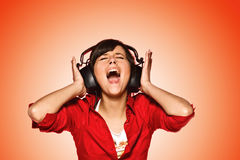 Favourite song. Young woman in headphones singing her favourite song Royalty Free Stock Photo