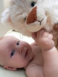 Favourite toy. Baby with a toy cat Royalty Free Stock Photo