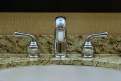 Fawcett e rubinetti di Chrome Fotografia Stock