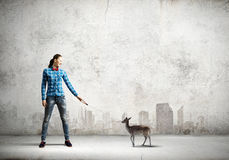 Fawn on lead. Young woman in casual holding fawn on lead Royalty Free Stock Images