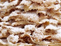 Faworki. Closeup shot of traditional Polish sweet crispy biscuits called Faworki with caster sugar Royalty Free Stock Photography
