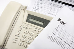 Fax. Detail of a fax machine with a cover sheet and other forms Stock Images