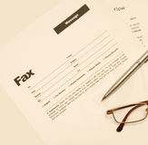 Fax message. A fax message concept with pen and eyeglass Stock Photography