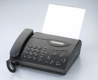 faxmaskintelefon Arkivbilder