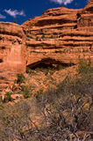 Fay Canyon Arch. The illusive Fay Canyon Arch often blends unseen into the background rocks unless the sun is overhead to light the gap behind.  Fay Canyon Trail Royalty Free Stock Images