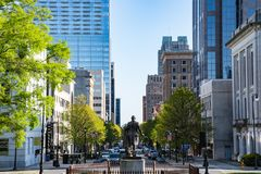 Fayetteville Street Raleigh, North Carolina. RALEIGH, NC - APRIL 17, 2018: George Washington Statue and Downtown Raleigh, North Carolina on Fayetteville Street royalty free stock image