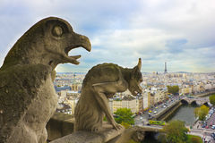 Faymous gargoyles of Notre Dame over Paris Royalty Free Stock Photo
