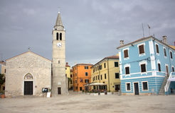 Fazana - Saints Cosma and Damiano church in a picturesque square Royalty Free Stock Photography