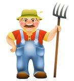 Fazendeiro com um forcado Foto de Stock Royalty Free