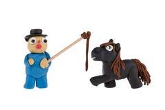 Fazendeiro e cavalo feitos do plasticine Fotografia de Stock