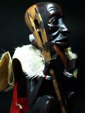 Fazendeiro preto assentado [St de madeira Imagem de Stock Royalty Free